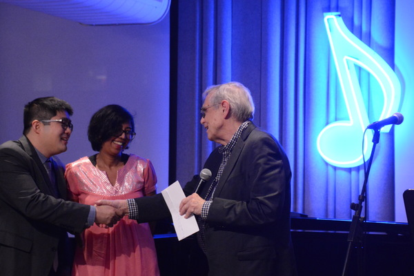 Mike Lew, Rehana Lew Mirza being presented the Kleban Prize by Richard Maltby, Jr. Photo