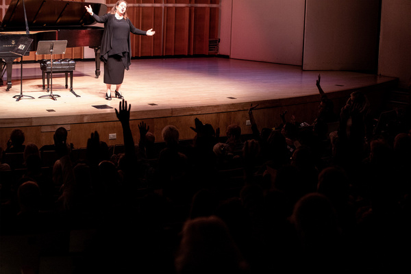Series host, soprano Allison Charney, engaging the PREformances audience in her signa Photo