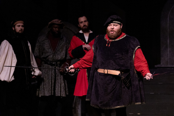 Tybalt (William Green) expressing his hatred for the Montagues.  Photo