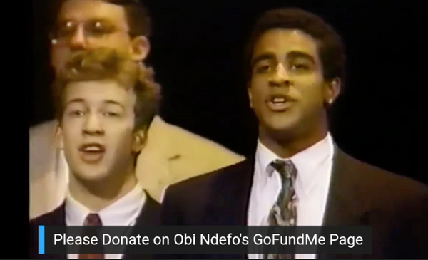 Back in his a cappella days... Obi Ndefo singing with the Baker''s Dozen on the Arsen Photo