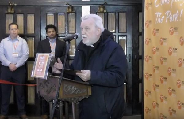 Rev. John Docherty of the Holy Family Parish, speaking at the ribbon cutting ceremony Photo