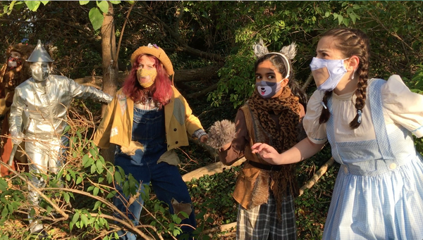 Members of the combined Ensemble perform The Wizard of Oz in BTC?s backyard. Photo