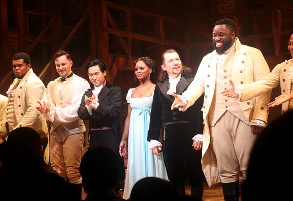 Jin Ha as Aaron Burr, Krystal Joy Brown as Eliza Hamilton, Miguel Cervantes as Alexan Photo