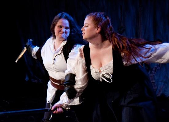 Murderer (Stephanie Repin) menaces Lady Macduff (Rachel Stubbs)