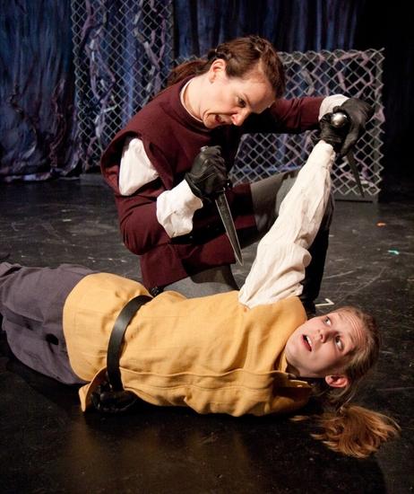 Macbeth (Kathrynne Wolf) defeats Young Seyward (Gillian N. Humiston) Photo