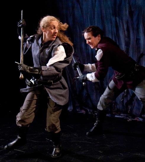 Macduff (Amy E. Harmon) defends herself from Macbeth (Kathrynne Wolf) Photo