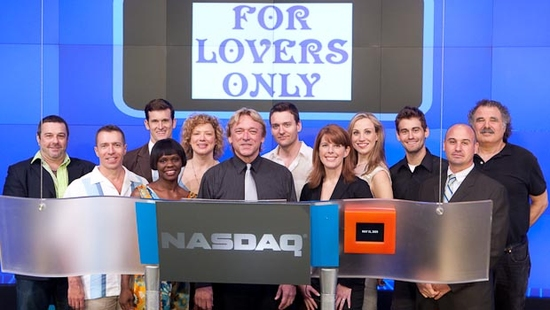 Musical Director Ken Lundie (front & center) surrounded by L to R: Director Christopher Scott; Associate Music Director Mark Akens; cast members Kevin Vortmann, Monica L. Patton, Dominique Plaisant, Glenn Seven Allen, Trisha Rapier, Christine Hope, Kevin  at FOR LOVERS ONLY Rings NASDAQ Closing Bell