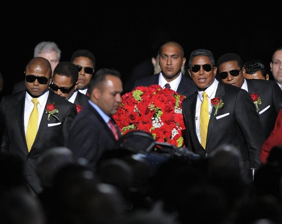 Randy Jackson, Tito Jackson, Marlon Jackon, Jermaine Jackson and family and friends carry Michael Jackson into the Staples Center