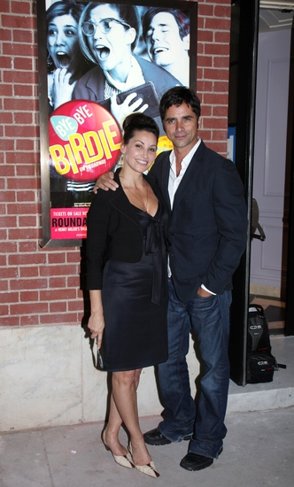 Gina Gershon and John Stamos