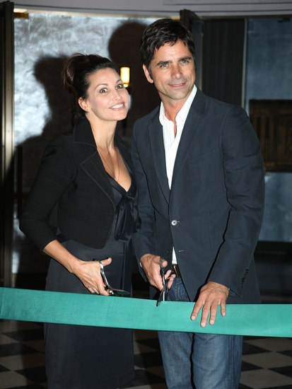Gina Gershon and John Stamos