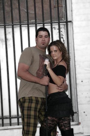 PJ Vasquez (Roger) and Christine Chemello (Mimi)
