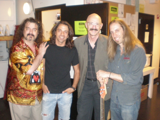 Doug Katsaros (keyboards/conductor), Chris Cicchino (guitar), Tony Levin, Dan Grennes (bass guitar)