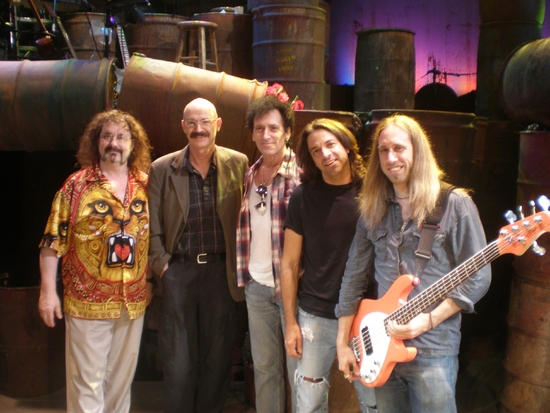 Doug Katsaros (keyboards/conductor), Tony Levin, Alan Childs (drums), Chris Cicchino (guitar), Dan Grennes (bass guitar)