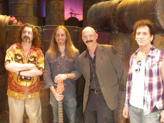 Doug Katsaros (keyboards/conductor), Dan Grennes (bass guitar), Tony Levin, Alan Childs (drums)