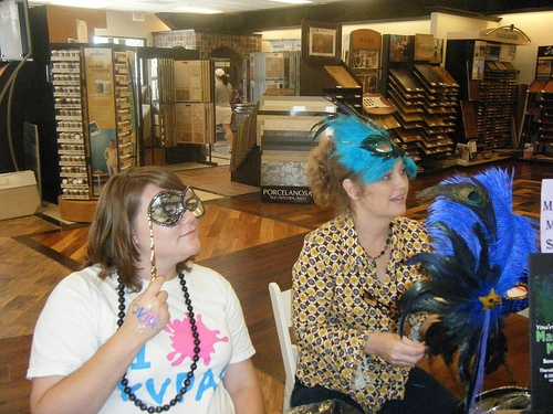 Stephanie Murphy (l) and KVPAC Board Benefit Chairperson, Teresa Kennedy, sell masks and tickets to the Masquerade & Martini Mixer at a recent Home Makeover Expo event in Katy