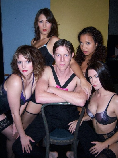 Jered Solace as The Emcee, surrounded by Kit Kat Girls: (Top Left and clockwise) Jennie Williams as Frenchie, Ayla Glass as Lulu, Krystal Heib as Rosie and Ashley Warnke as Fritzie