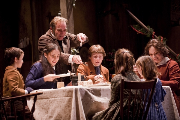 John Babbo (Tiny Tim), Lauren Patten (Martha Cratchit), Ron Rains (Bob Cratchit), Nathan Sabo (Peter Cratchit), Mackenzie Wilkin (Belinda Cratchit), Caroline Heffernan at Goodman Theatre's A CHRISTMAS CAROL