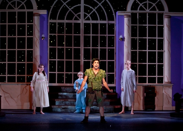 John Paul Soto as Peter Pan (foreground) and in background from left to right, Kelly Smith as Wendy, Stephen Sandham as Michael and Lincoln Sandham as John