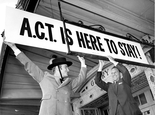 A.C.T.'s founding artistic director, William Ball (left), and Mortimer Fleishhacker, one of the San Francisco civic leaders who secured A.C.T.'s residency at the Geary Theater in 1967, put up the sign announcing A.C.T.'s new home