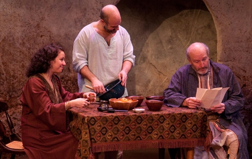 Wife Ambara (Suehyla El-Attar) and husband Yusef (Demosthenes Chrysan) discuss rebellion against British rule with their friend Hajj Waleed (Tom Thon). at TENNIS IN NABLUS Plays the Alliance Thru 2/21