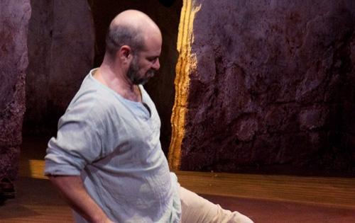 Yusef (Demosthenes Chrysan) is held in prison.