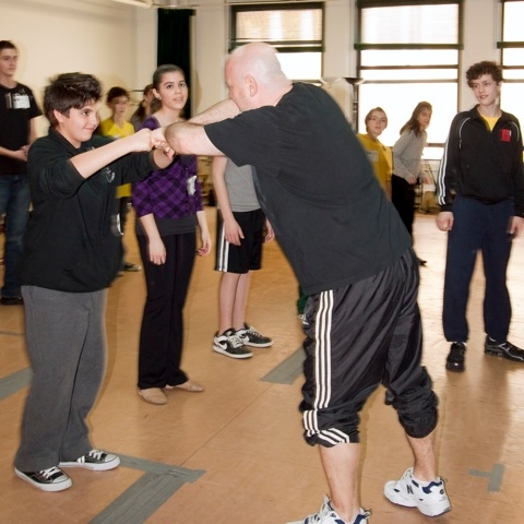 Thommie Retter teaches students the dance