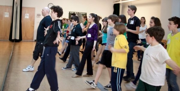 Trent Kowalik and Thommie Retter practice the dance from the Billy Elliot finale with the students