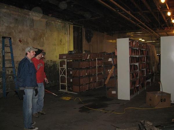 Josh Kessler, Andy Batt survey the previous owner's files