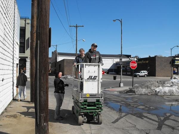 Andy Batt, Josh Kessler take a ride to put AC units on roof