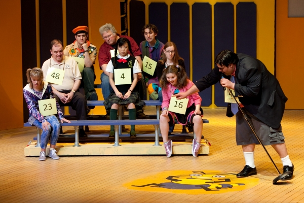 Devon Meddock (Olive), audience speller, Jude McCormick (Chip), audience speller, Timothy Allen (Leaf), audience speller, Kelly Smith (Logainne); center Robin Lee Gallo (Marcy); and far right Patrick Ciamacco (Barfee)