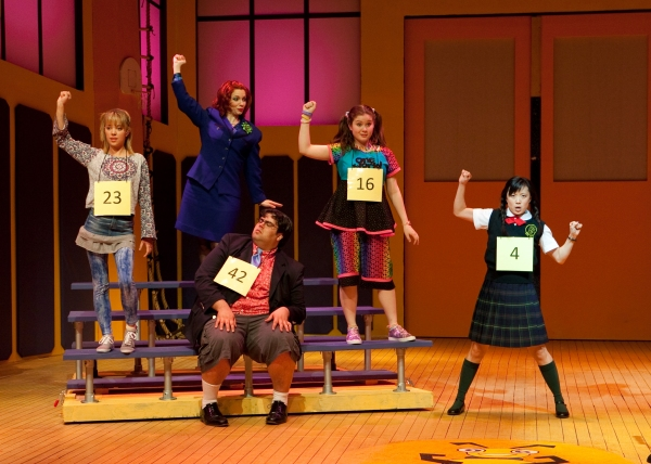 Devon Meddock (Olive Ostrovsky), Tricia Bestic* (Rona Lisa Perretti), Kelly Smith (Logainne Schwartzandgrubenniere), and Robin Lee Gallo* (Marcy Park); center/sitting, Patrick Ciamacco (William Barfee)