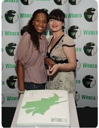 Alexia Khadime and Dianne Pilkington cut the cake at Wicked's birthday party