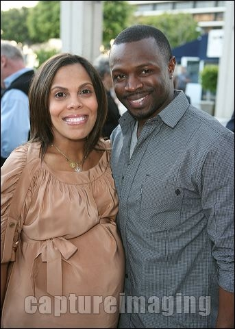Sean Patrick Thomas (R) and pregnant wife Aonika Laurent Thomas