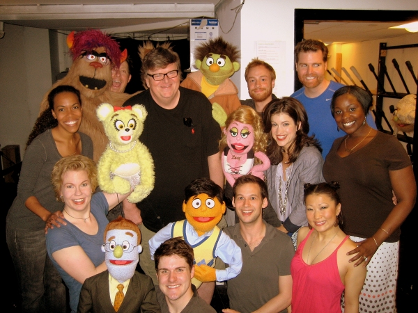 Michael Moore and the cast of Ave Q at Michael Moore Visits AVENUE Q