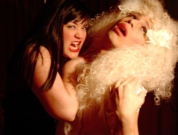 """Mary Hollis Inboden as The Succubus and Anthony DiNicola as The Virgin Sacrifice in """"Vampire Lesbians of Sodom"""" by Charles Busch. Photo by William Scott"""