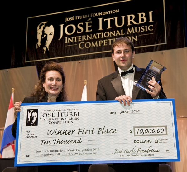 Donelle Dadigan Co-Founder & President with the winner of First Prize for piano, Staninslav Kristenko at Jose Iturbi Foundation Music Competition