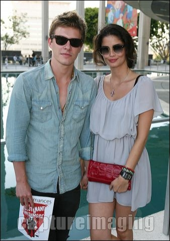 Xavier Samuel (L) and Shermine Sharivar