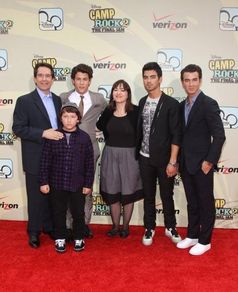 Kevin, Nick and Joe of The Jonas Brothers, along with Gary Marsh, Carolina Lightcap (Disney execs) and Frankie Jonas