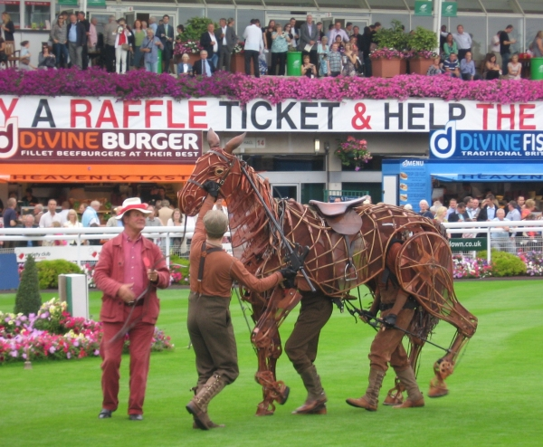Michael Morpurgo with Joey (puppeteers from l to r - head - David Emmings, Heart - To Photo
