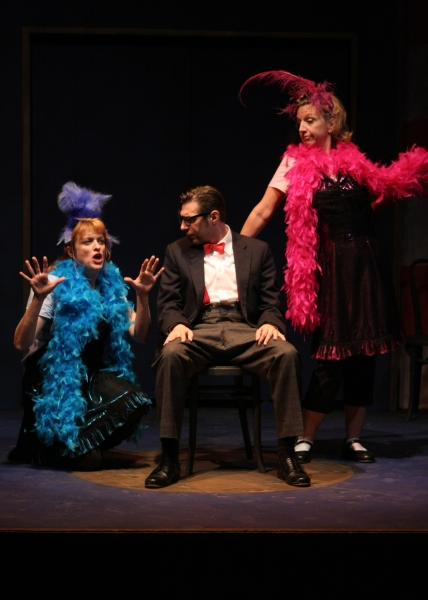 Young Dudley (Joseph Scrimshaw) gets lessons on life and world politics from the chorus girls (Shanan Custer and Michelle Hutchison) of the Vaudeville circuit