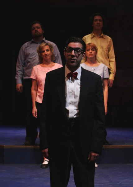 Dudley (Joseph Scrimshaw) stands with the ensemble (l to r: Matt Erkel, Paul de Cordova, Michelle Hutchison, and Shanan Custer).
