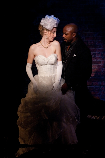Victoria Frings as Polly Peachum and Terence Archie as MacHeath