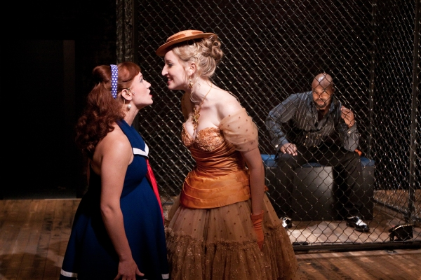 (L-R) Liz Filios as Lucy, Victoria Frings as Polly Peachum and Terence Archie as MacH Photo