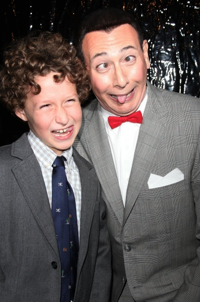 Paul Reubens as Pee-Wee Herman with a young fan