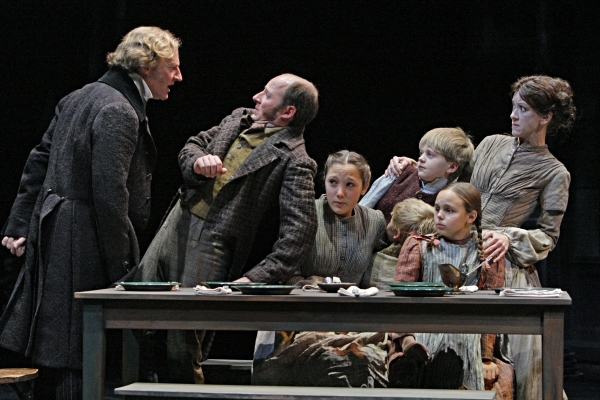 Daniel Gerroll (Ebenezer Scrooge), Kris L. Nelson (Bob Cratchit), Kate Howell (Martha Cratchit), Noah Coon (Peter Cratchit), Elizabeth McCormick (Belinda Cratchit), Noah Ross (Tiny Tim) and Virginia S. Burke