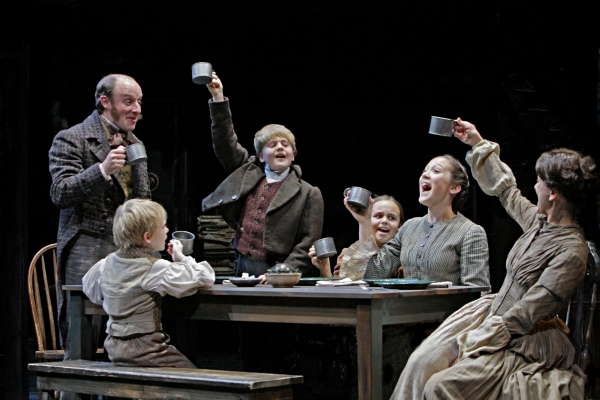Kris L. Nelson (Bob Cratchit), Noah Ross (Tiny Tim), Noah Coon (Peter Cratchit), Elizabeth McCormick (Belinda Cratchit), Kate Howell (Martha Cratchit) and Virginia S. Burke