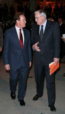 Former Govenor Arnold Schwartzenegger (L) talks with Board Chairman Thomas McKernan