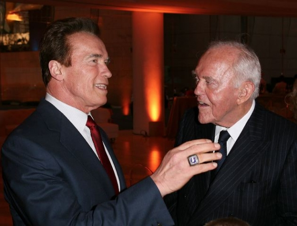Former Govenor Arnold Schwartzenegger (L) congratulates Founding Chairman Henry Segerstrom  at OCPAC Renaming Ceremony