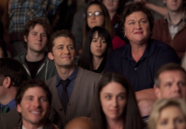 Will (Matthew Morrison, L) and Coach Beiste (Dot-Marie Jones, R) watch the glee club perform