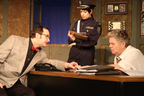 The Madman (Joseph Stearns, left) explains himself to Officer #1 (Elizabeth Bagby, center) and Bertozzo (Vincent Lonergan, right)